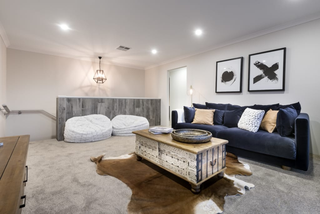 blue velvet lounge & cowhide rug and chair